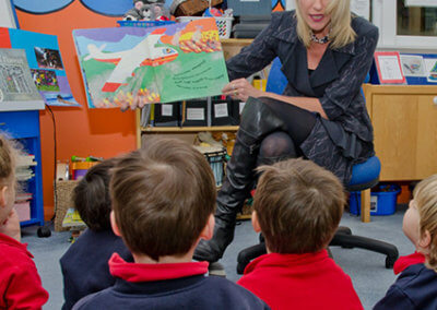 About page gallery, Maria teaching children