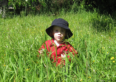Environment design gallery, child sitting in tall grass