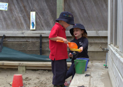 Vision and values gallery, two children playing in sandpit together