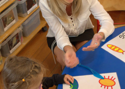 About page gallery, Maria and children playing with play dough